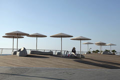 Modern beach promenade with umbrellas in Tel Aviv, Israel. Modern beach promenade with umbrellas and relax seat in Tel Aviv, Israel Stock Photos