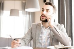 Modern bearded businessman working in cafe royalty free stock photo