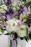 Modern beautiful bouquet of buttercup ranunculus, fresia, lavender flowers on white background. Wedding style concept Stock Photography