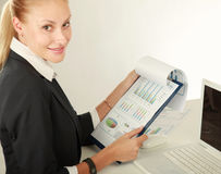 Modern beautiful business woman in the office Stock Images