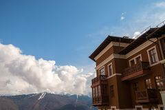 Modern beautiful house on the background of mountains. royalty free stock photography