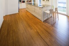 Modern cream kitchen. Modern beautiful kitchen and parquet in design house royalty free stock images