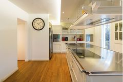 Modern cream kitchen. Modern beautiful kitchen and parquet in design house royalty free stock photography