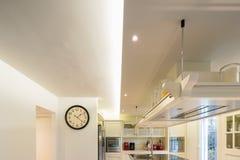 Modern cream kitchen. Modern beautiful kitchen and parquet in design house stock image