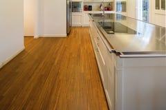 Modern cream kitchen. Modern beautiful kitchen and parquet in design house stock photography