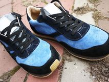 Modern, beautiful men`s sneakers for moving around the city and traveling. These sneakers are suitable for any age and any style o stock images
