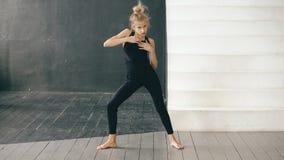 Modern beautiful teenage girl dancer perfomance contemporary dance in ballroom indoors. Modern beautiful teenage girl dancer perfomance contemporary dance in stock photo