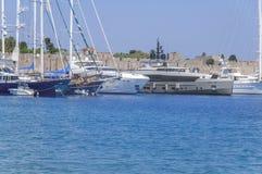 Modern beautiful travel fancy yacht docked at marina dock. At blue sea royalty free stock image