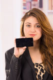 Modern beautiful young woman holding cell phone Royalty Free Stock Photo