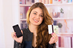 Modern beautiful young woman holding cell phone Royalty Free Stock Photos