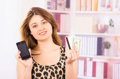 Modern beautiful young woman holding cell phone Stock Photos