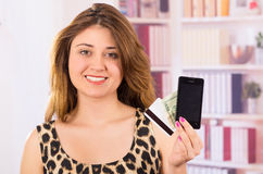 Modern beautiful young woman holding cell phone Royalty Free Stock Images