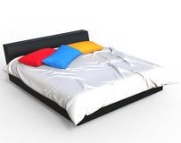 Modern bed - bright colored pillows Royalty Free Stock Photo