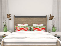 Modern bed with colorful decoration Stock Photography