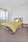 Modern bed interior with more space on the floor Royalty Free Stock Photography
