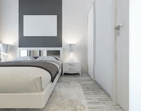 Modern bed with mirrored headboard and bedside tables with lamps Stock Photos
