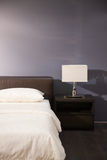Modern bed room interior. Lamp and pillows in a new house Stock Images
