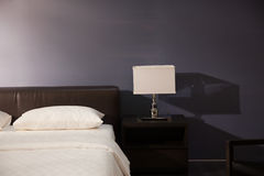 Modern bed room interior. Lamp and pillows in a new house Royalty Free Stock Photos
