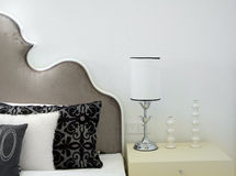 Modern bed room interior. Lamp and pillows Royalty Free Stock Images