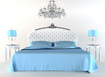 Modern bed tith night lamps and chandelier. Stock Photography