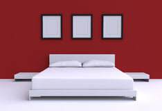 Modern bed with two pillows against the wall of the room. Royalty Free Stock Image