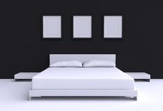 Modern bed with two pillows against the wall of the room. Royalty Free Stock Photos