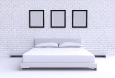 Modern bed with two pillows against the wall of the room. Royalty Free Stock Photo