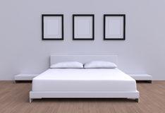 Modern bed with two pillows against the wall of the room. Stock Image