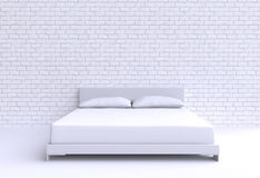 Modern bed with two pillows against the wall of the room. Stock Photography