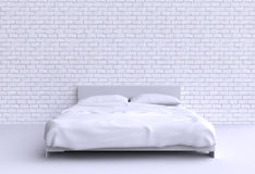 Modern bed with two pillows against the wall of the room. Stock Images