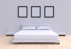 Modern bed with two pillows against the wall of the room. Stock Photos
