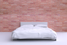 Modern bed with two pillows against the wall of the room. Stock Photo