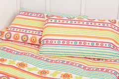 Modern bedding set with geometric shapes Stock Photos