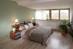 Modern Bedroom. A modern and comfortable bedroom. The room is decorated in a contemporary style, with wooden flooring stock photography