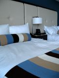 Modern bedroom. A photo of and modern bedroom with a stripped comforter stock image
