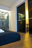 Modern bedroom. A modern home interior with a bedroom and reflective surface door