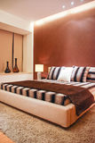 Modern bedroom. Wide shot and very bright Stock Photography