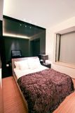 Modern bedroom. With bed and lamp Stock Photography