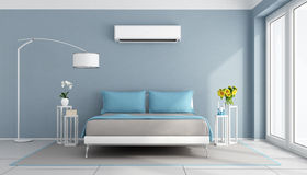 Modern bedroom with air conditioner Royalty Free Stock Image