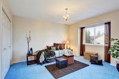 Modern bedroom with blue carpet floor Stock Photo