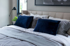 Modern bedroom with blue pillows Royalty Free Stock Photos