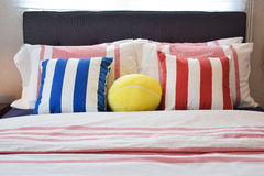 Modern bedroom with blue,yellow and red striped pillows Stock Image