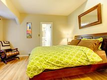 Modern bedroom with bright green bed spread. Stock Photos