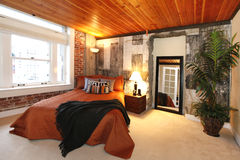 Modern bedroom with a broken concrete wall Royalty Free Stock Image