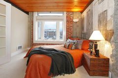 Modern bedroom with a broken concrete wall Stock Photos