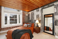 Modern bedroom with a broken concrete wall Royalty Free Stock Photo