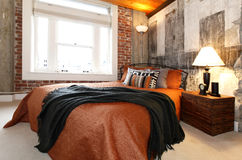 Modern bedroom with a broken concrete wall Stock Photography