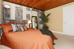 Modern bedroom with a broken concrete wall Stock Image