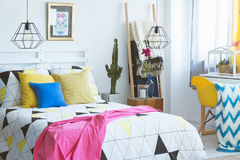 Modern bedroom with colorful accents. Cozy bedroom with colorful accents, modern furniture and folk details Stock Photo