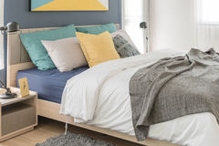 Modern bedroom with colorful pillows Stock Photos